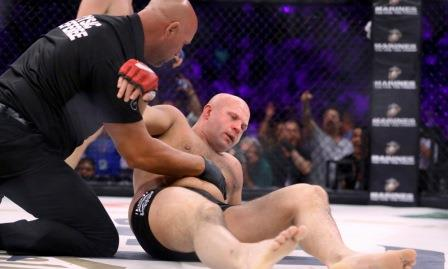 Fedor Emelianenko is tended to by the ref after being stopped by Matt Mitrione in a mixed martial arts bout at Bellator 180 on Saturday, June 24, 2017, in New York. Mitrione won via first round stoppage. (AP Photo/Gregory Payan)